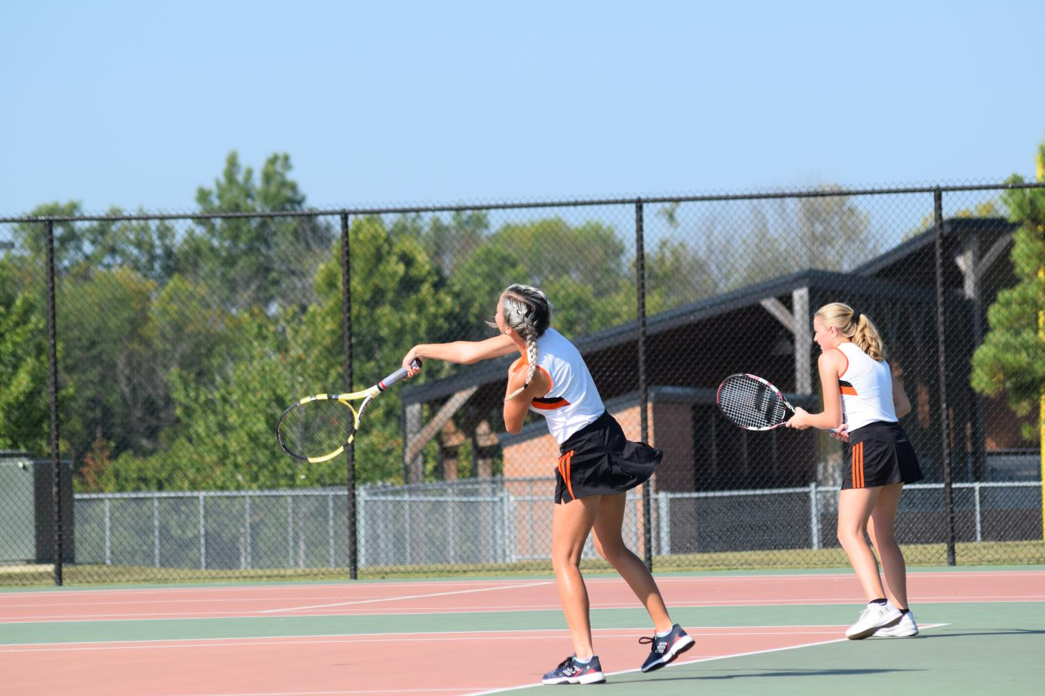 Doubles partners, Kelby Weber (9) and Bryndle Burks (11) fight for a win at the Mt. Vernon Invite.
