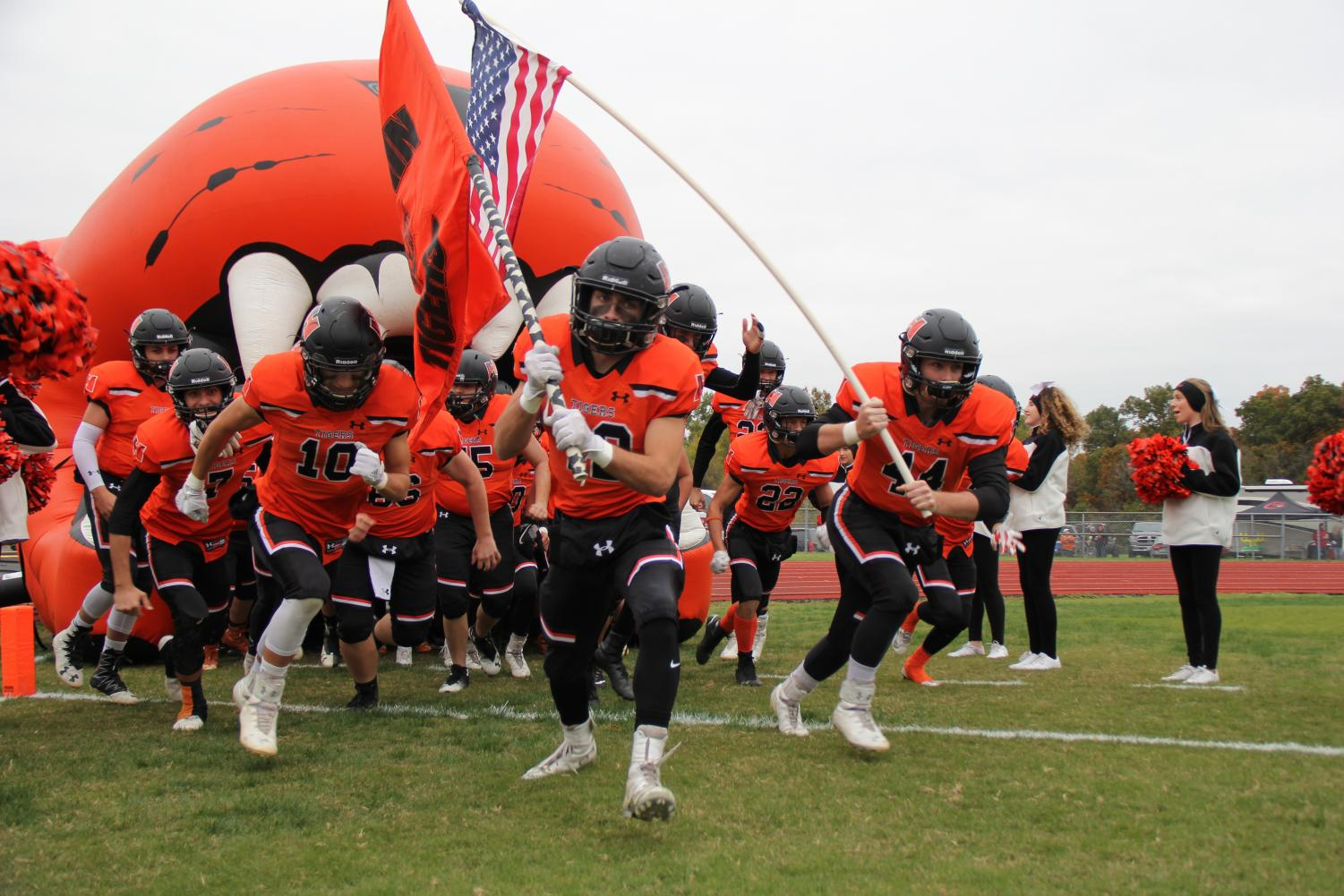 Seniors, Kyle Matuzak and Jase Gosha lead the team onto the field for round 1 of the playoffs.