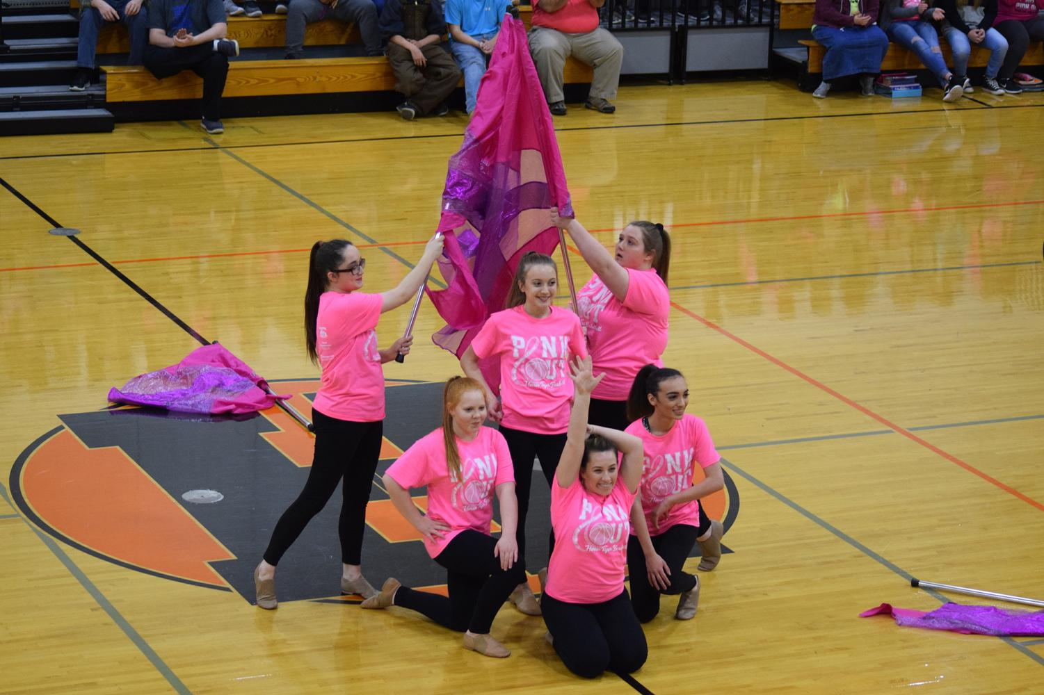 The Herrin High flag team strikes a pose after successfully performing a routine for the Pink Out pep rally.