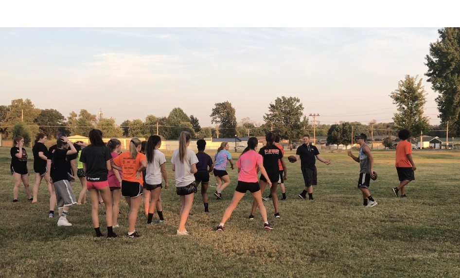 Sophomore PowderPuff girls take on their first practice with Brocton Graul, Collin Coriasco, and Ricky Branch as team coaches.