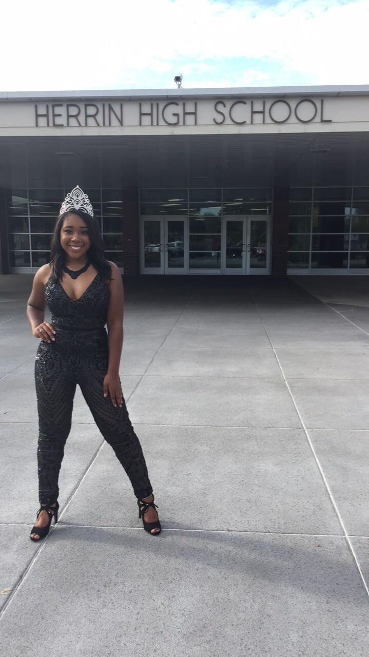 Looking gorgeous as always HHS's Homecoming Queen, Kaiyah King poses in front of Herrin High School before the parade on Friday
