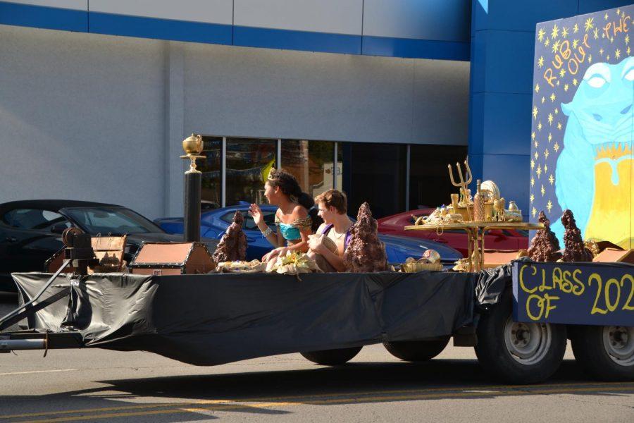 Waving like royalty, Jasmine(Cece Kiesling) and Alladin (Keaton Rosado) ride the freshman class float.