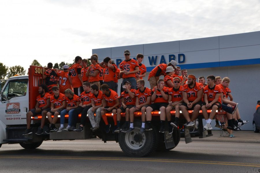 Herrin's varsity football team takes a ride in the back of South Side Lumber's truck.