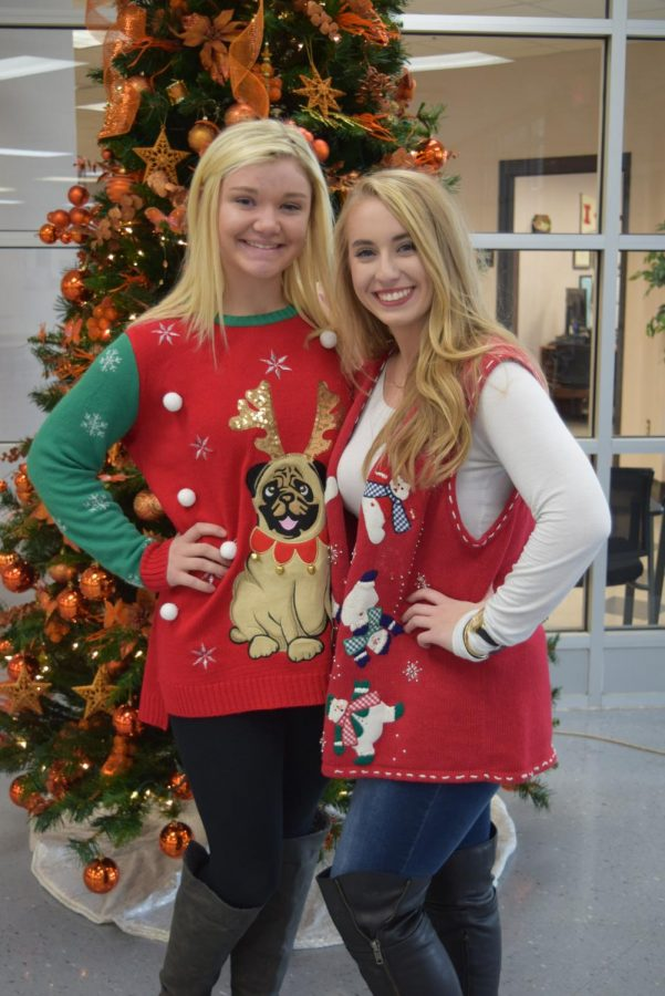 Seniors, Miranda Russell and Mikaylan Roach strike a pose in from of the Tiger Christmas tree.