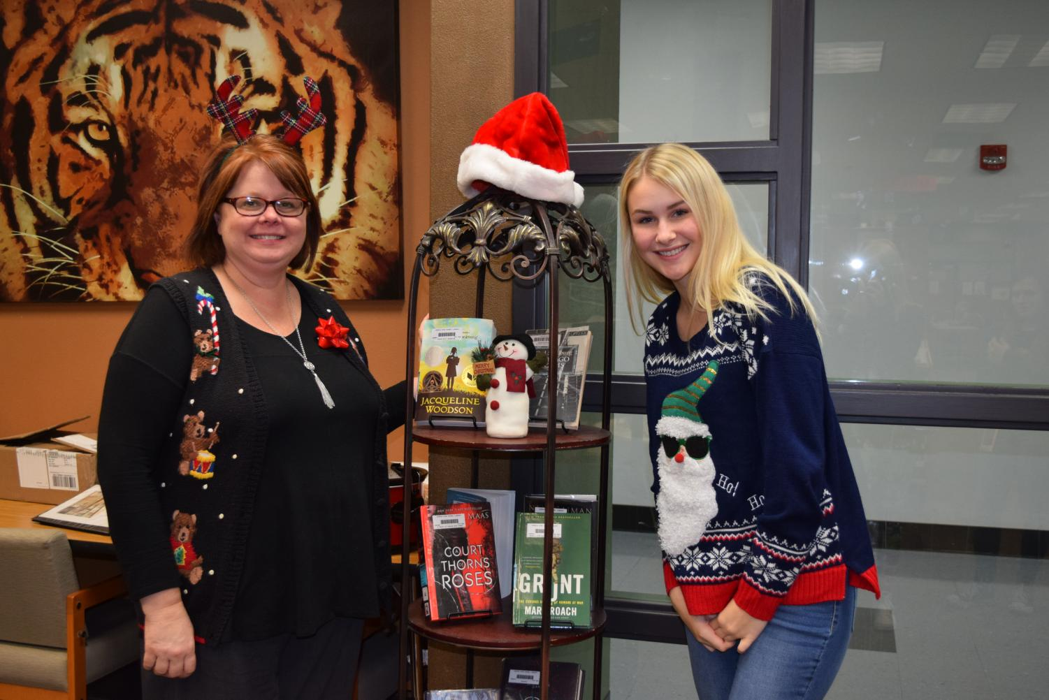 Mrs.+Johnson+with+student+helper%2C+Sydney+Nugent%2811%29+pose+with+the+%22cool+Christmas+book+stand.%22