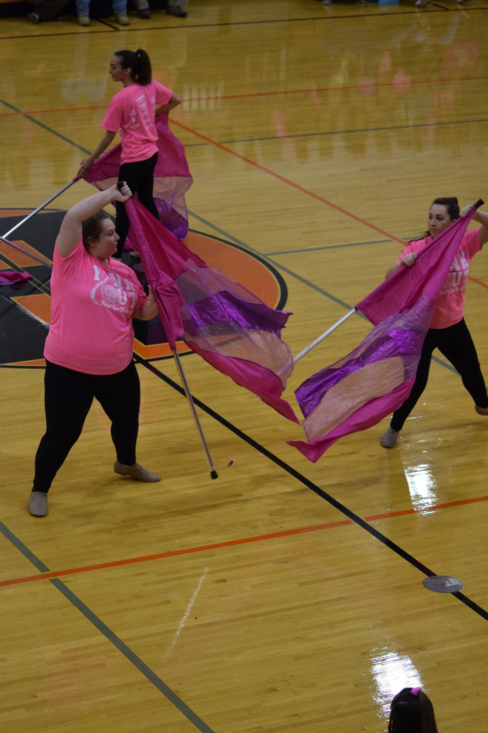 Allison+Berry+%2811%29+and+Cecily+Smith+%2811%29+switch+flags%2C+performing+a+spectacular+move+during+the+pep+rally.+