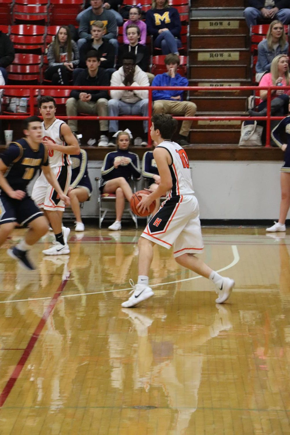 Senior Bronson Nesler dribbles the ball to the other side of the court.