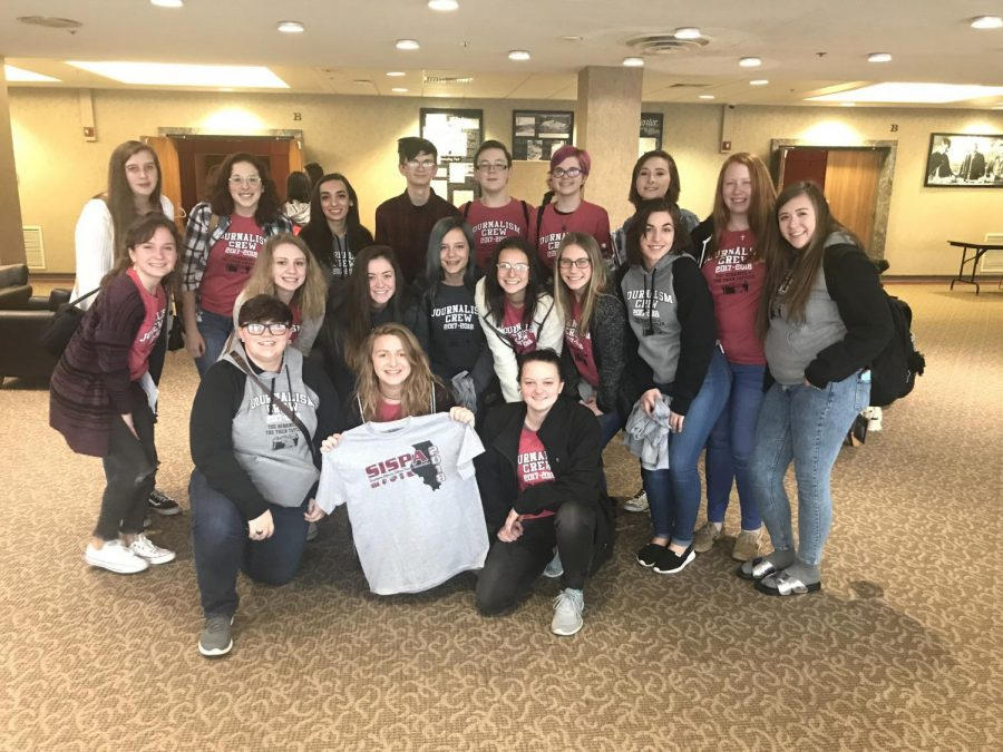 Grinning for the camera, Herrin High's journalism kids sport their Tiger pride at the SISPA Winter Conference.