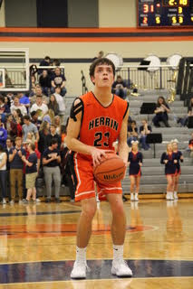 Junior Drew Ringel prepares to shoot a freethrow.