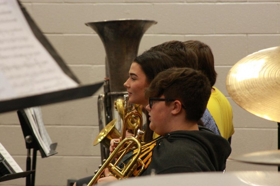 The brass section waits for their cew from director, JTLewis