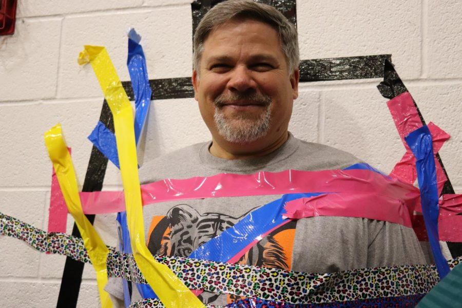 Mr. Johnson smiles at the camera to show off his colorful duct tape!