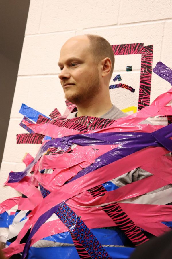 Mr. Mason doesn't look so happy about having duct tape all over him