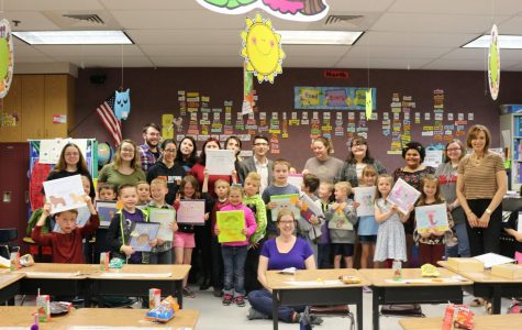 Mrs. Johnsons 1st grade class and Mrs. Wilsons creative writing class take pictures with their books!