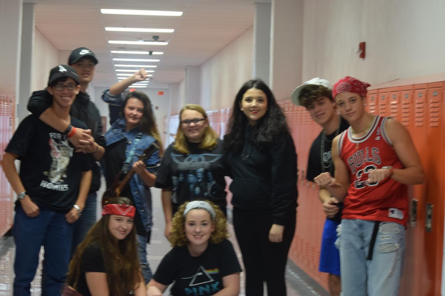 HHS+students+pose+in+the+hallway+showing+their+tiger+spirit.+
