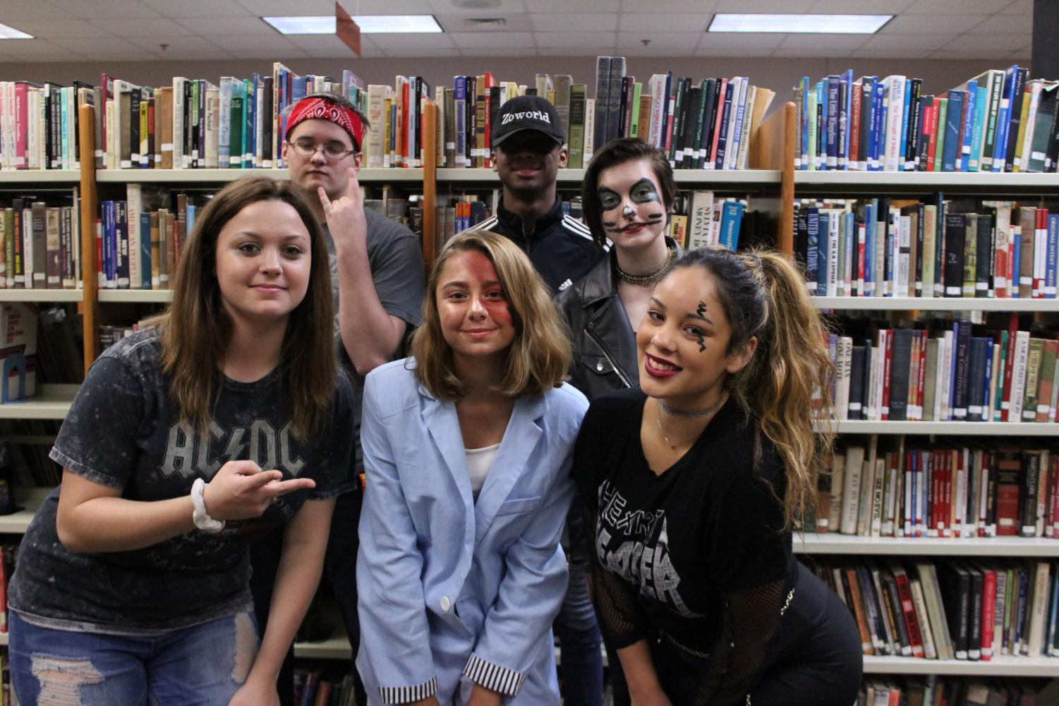 Mrs.+Johnson%27s+library+workers+pose+together+for+a+quick+picture.+