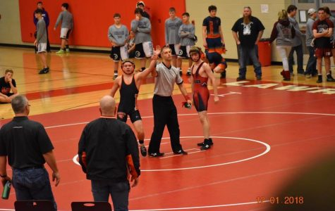 Photo by: Mike McGinnis Anthony Bowling proudly raising his hand after winning a match.
