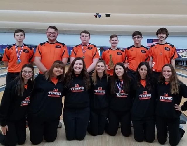 The boys and girls bowling team smile at their successes.