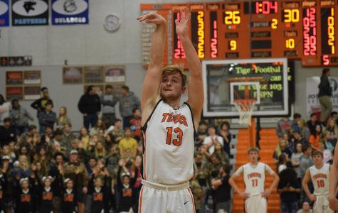 Garrett Venegoni focuses on making the basket.