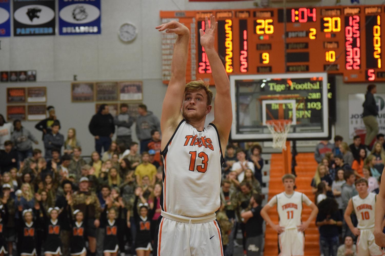 Garrett Venegoni focuses on making the basket.