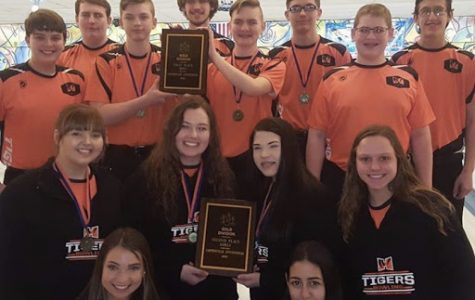 The Boys and Girls Bowling team show off their new hardware.