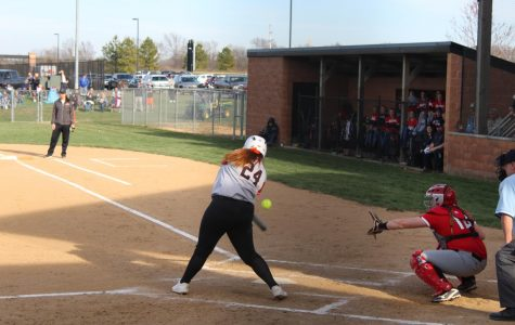 Junior Alexandria Paintner swings at a fastball from a Johnston City pitcher.