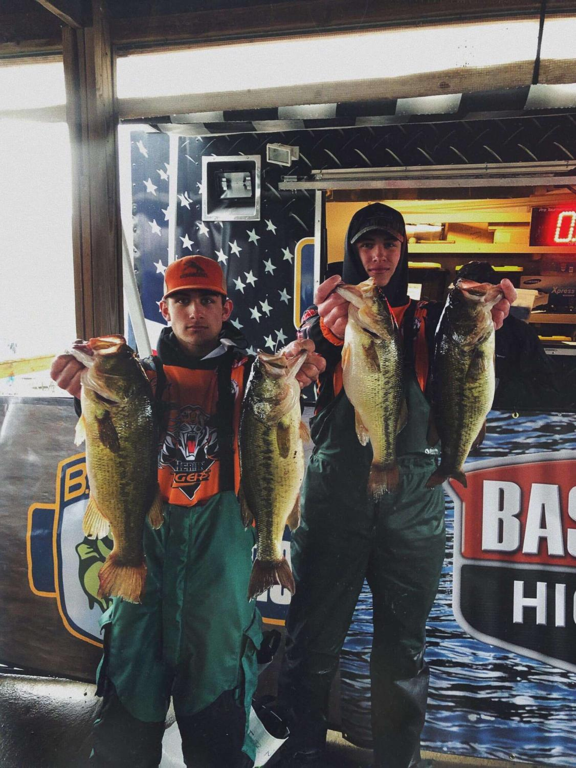 Gunter Gotha (10) and Matthew Brandon (11) show off their catches at the end of a long day on the lake.