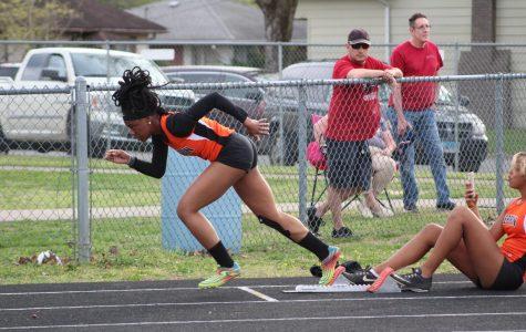 Vanity Tucker (11) taking off during the 400 meter race the West Frankfort track meet.