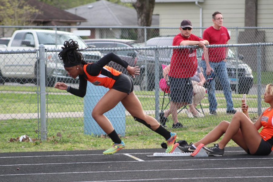 Vanity Tucker (11) taking off during the 400 meter race the West Frankfort track meet.