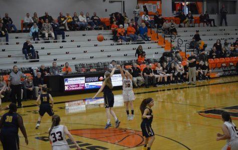 Senior Morgan McKinnies shoots a three point shot against the Marion Wildcats.