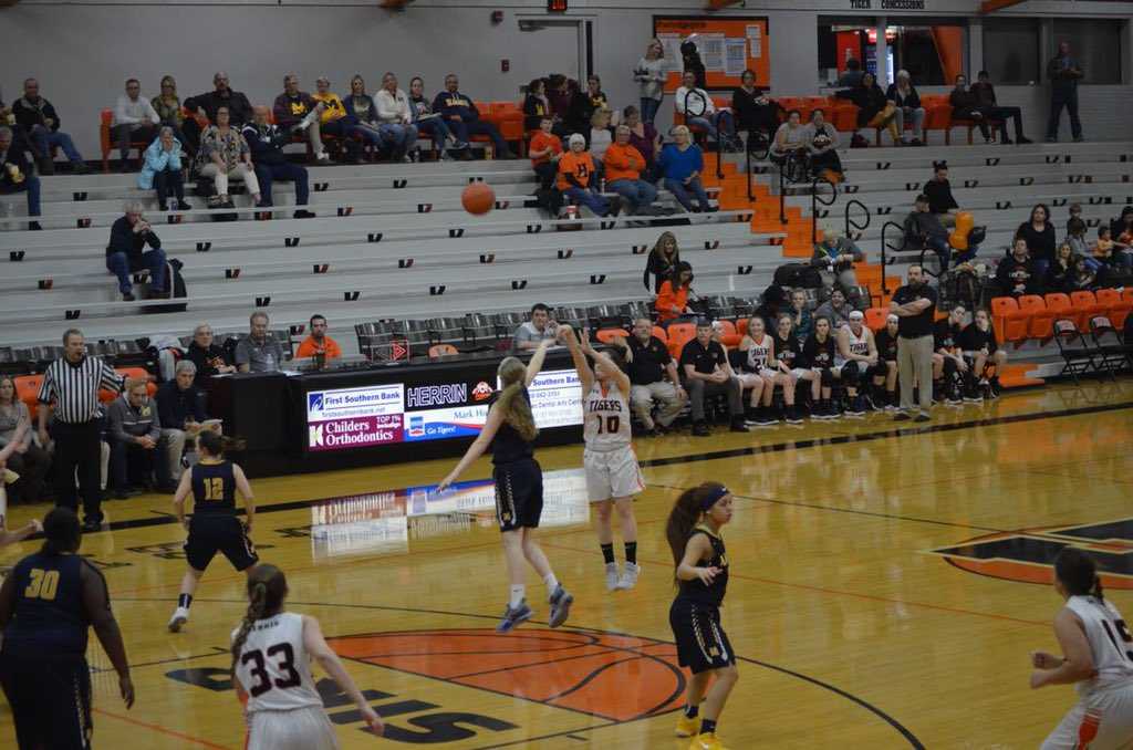 Senior Morgan McKinnies shoots a three point shot against the Marion Wildcats.