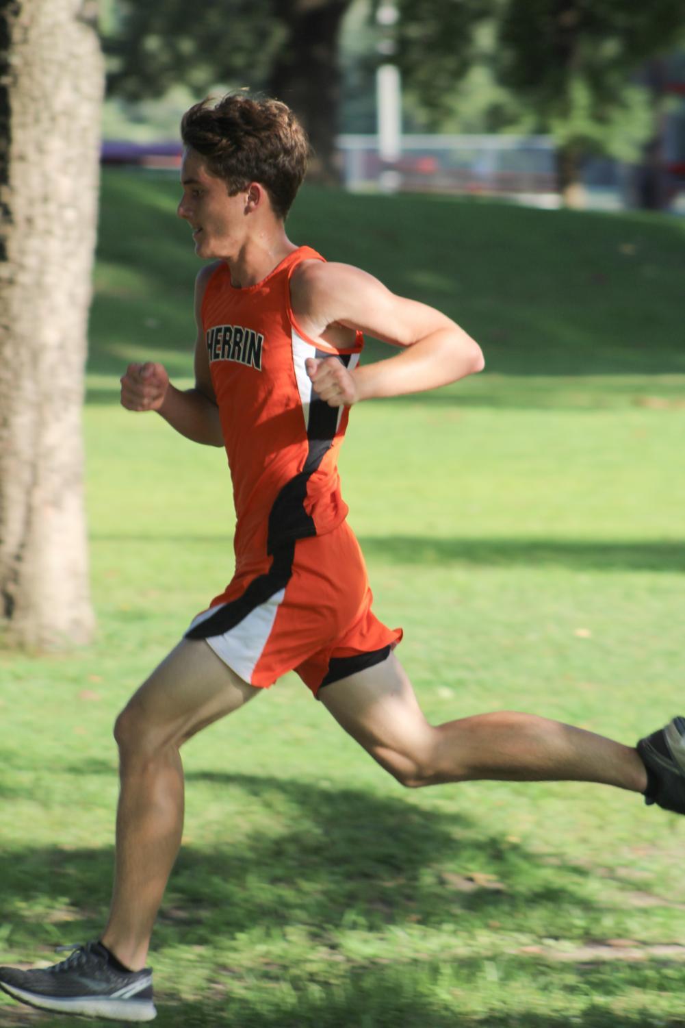Cameron Christ (9) speeds up while running towards the finish line on August 27th at West Frankfort.