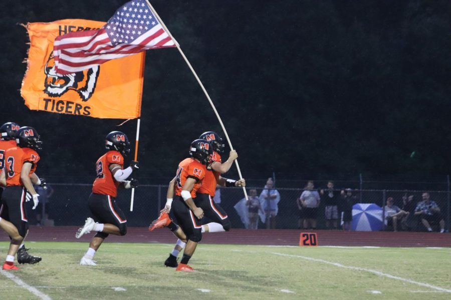 The Herrin Tigers run out before the game starts.