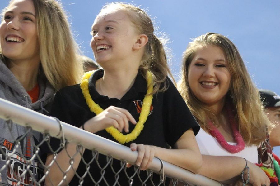 Ainsley Farmer (11), Emily Spiller (11), and Kristina Yoast (11) crack jokes while waiting for the game to start.