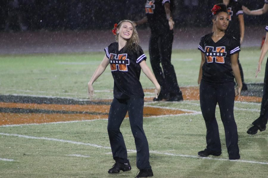 Shanie May (12) dances her heart out during the half time performance at the Benton versus Herrin football game.