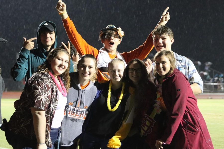 The Loud Crowd doesn't mind standing in the rain to support the Tigers.