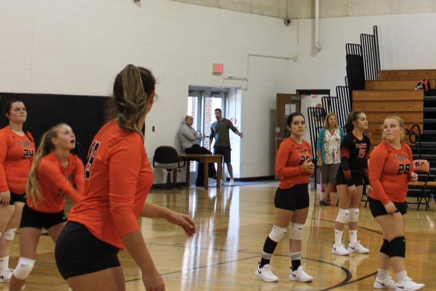 Julia Mohr, 11, stays alert while Karley Keel, 10, gets ready to pass on August 29 at the home opener