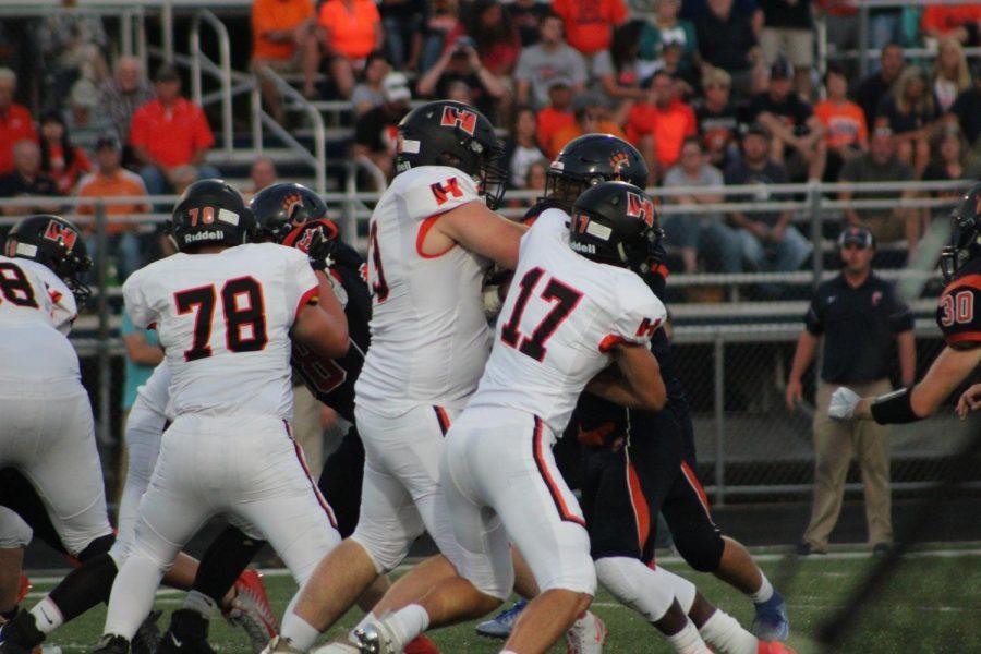 The offensive line block Cartervilles running back.
