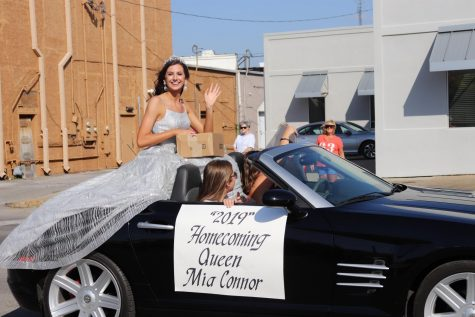 Homecoming Queen, Mia Connor (12) smiles at the Homecoming parade.