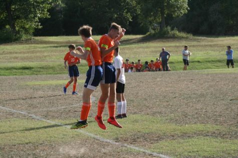 Jake Baumgarte (12) and April Knight (12 of Carterville) celebrate after scoringh a goal against Mt. Vernon on September 26th.