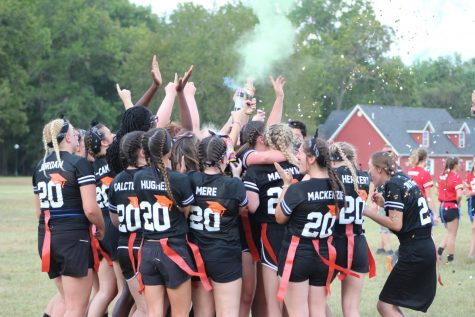 The senior class blasts confetti in honor of winning the 2019 powderpuff football game.