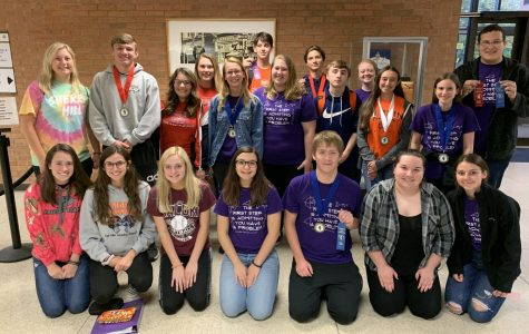 The Math Team proudly showcases their medals and ribbons after dominating round three of four of the SWIC series.