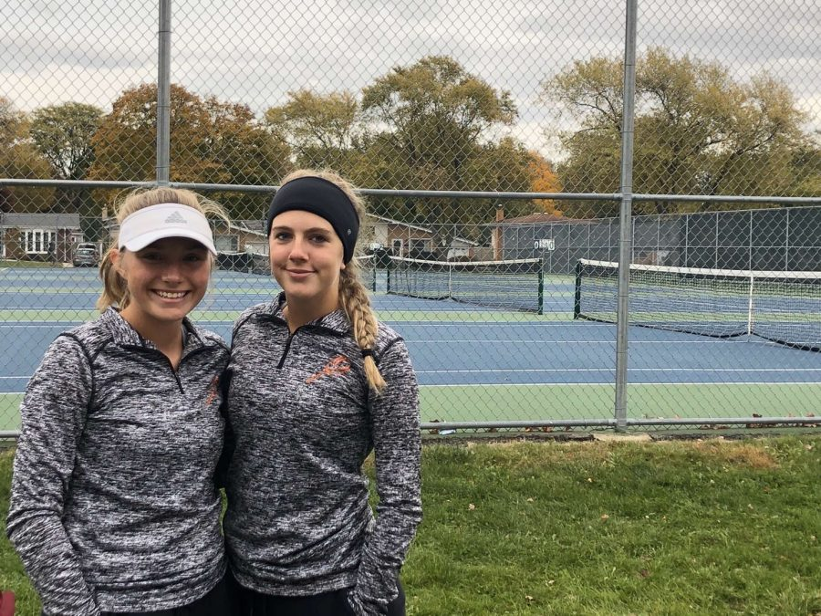 Kelby+Weber+%2811%29+and+Breanna+Nesler+%2811%29+pose+for+a+picture+in+front+of+the+courts+that+they+competed+at+State+on.
