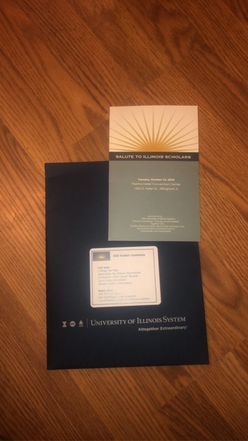 Students who attended the Salute to Scholars event received a folder with information about collegees in the stat of Illinois, as well as help with applications.