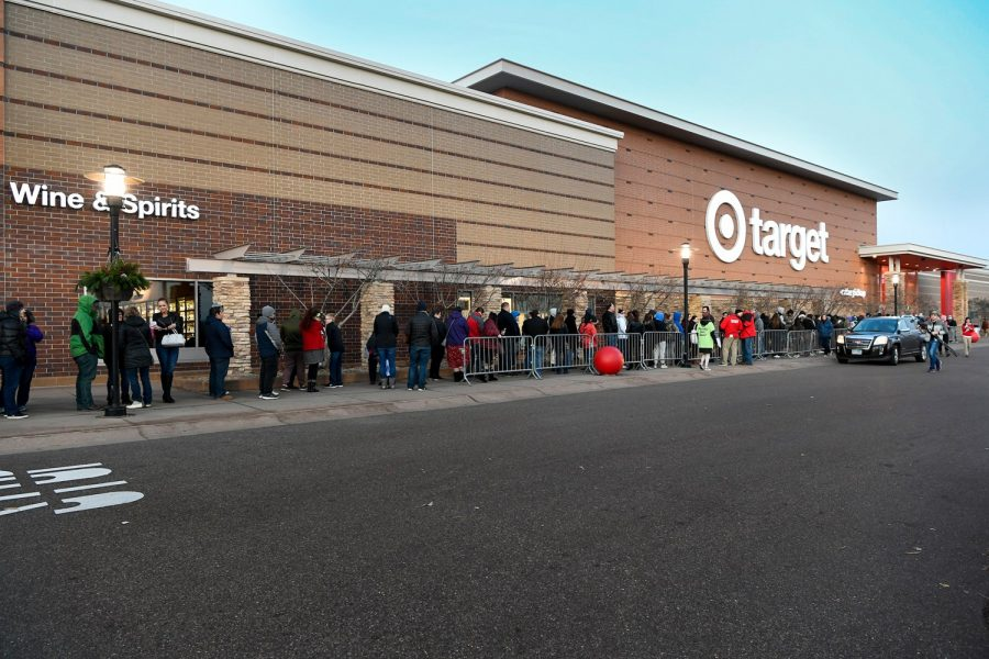 Shoppers line up to get the best deals before the madness begins.