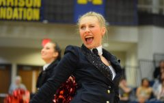 Shanie May (12) winks at the judges while performing a pom routine at the I.D.T.A. Marion Regional Contest.