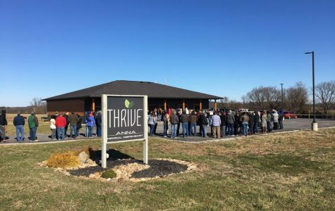 Hundreds of citizens line up outside Thrive, the new marijuana dispensary in Anna, as the new law was passed.