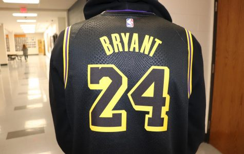 Kaden Bigler (11) celebrates Kobe Bryant's life by wearing one of his jerseys.