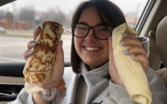 Noelle Cocke (10) holds up a Taco Bell Breakfast Burrito next to a Sonic Breakfast Burrito.