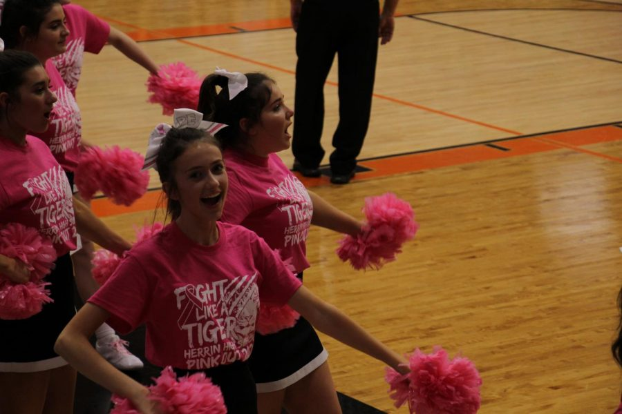 Gracie Griffin (9) cheers on the Tigers during the PINKOUT game.