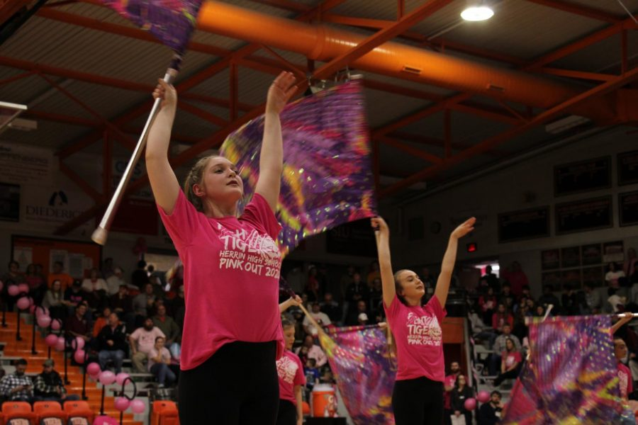 Brianna Parkis (11) and Hayley Franklin (11) perform a dramatic lyrical routine during half time.